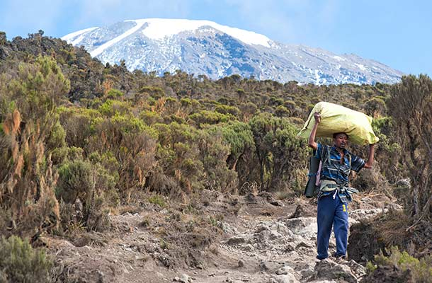 Kilimanjaro Porters: Help Them Help You Up The Mountain