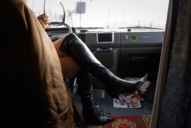 Woman with knee high leather boots