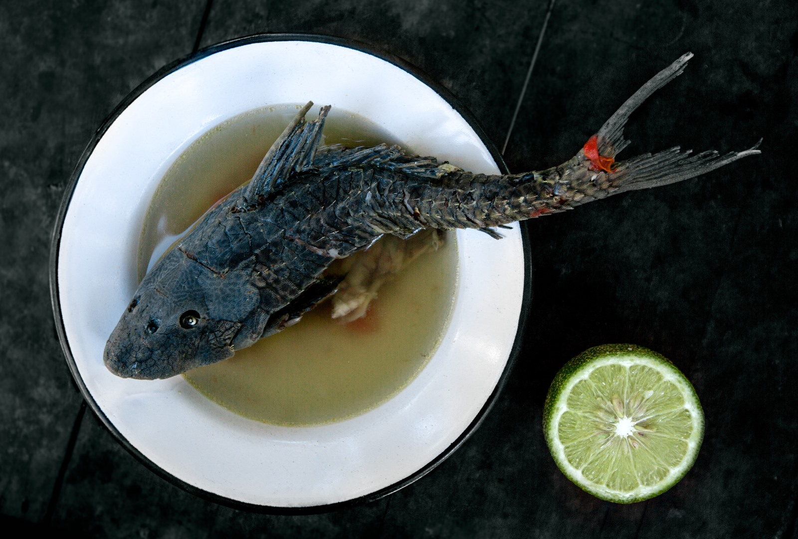 """Ipo,"" the tribe's name for their favorite catfish with its famous zig-zagging scales. After the heart is removed, it is cooked whole in a salt and onion broth."