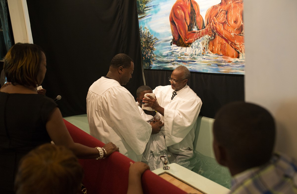 A young boy is baptized at Mount Zion Baptist Church in Yazoo City.