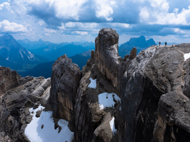 Two climbers overlook the ridges and faces of the Via Ferrata Punta Ana.