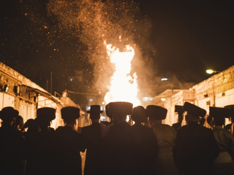 Ultra-Orthodox people pray in front of a huge bonfire during the celebration of Lag BaOmer, a sacred feast that belongs to Jewish mysticism.