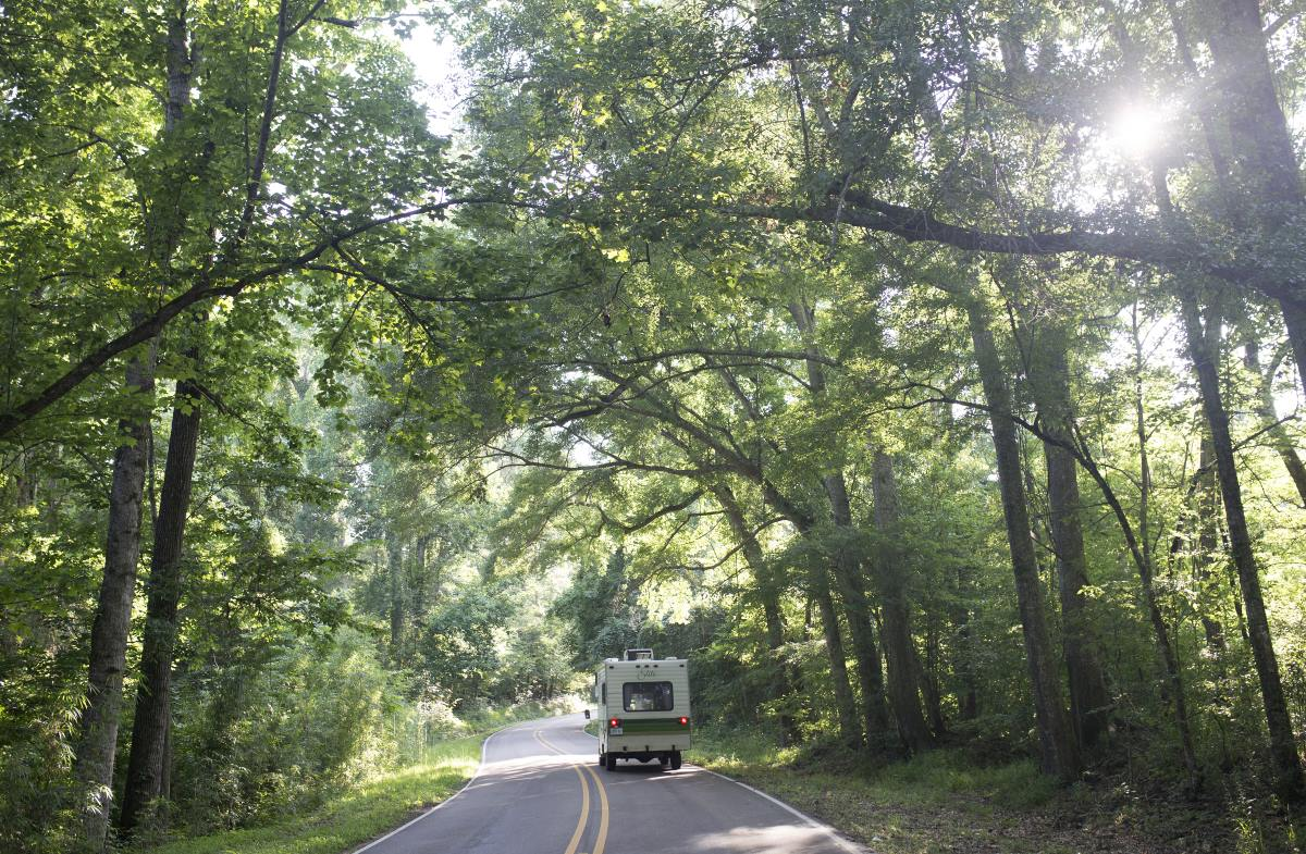 The RV drives through the Natchez Parkway.