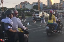 WATCH: Crossing Ho Chi Minh's Notoriously Busy Roads