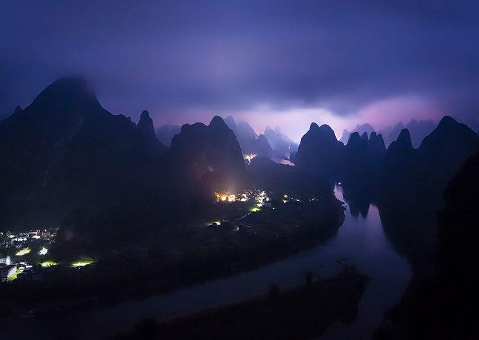 Xingping, China. Even in a downpour, towering above the tiny Chinese villages below and surrounded by the karst landscape was surreal. Along this river, lies one of the most interesting and oldest traditions in the country.